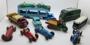 A collection of twelve Dinky Toys model vehicles, including racing cars, BBC Mobile Control Room and