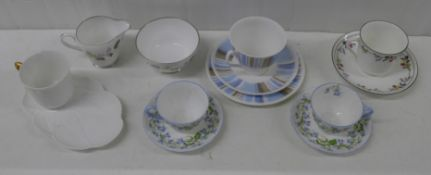 A Shelley Regency trio, a pair of Harebell cups and saucers, two cups and saucers and a sugar bowl