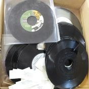 A collection of jukebox 7'' singles including Oasis, Blur, Stone Roses, Queen, Def Leppard, Bon