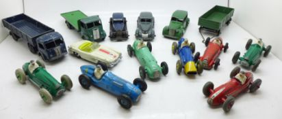 A collection of twelve Dinky Toys model vehicles, including seven racing cars and one Corgi Toys