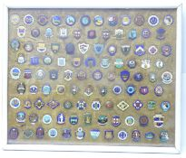 A collection of lawn bowls clubs and associations badges, framed