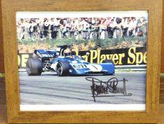 Formula 1; a framed and signed photograph, Jackie Stewart, frame 24 x 29cm