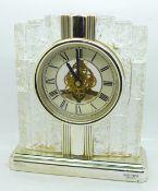A glass mounted Rhythm quartz clock, height 20cm