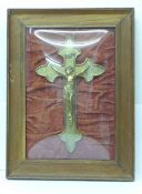A framed and mounted crucifix under 'domed' glass, width of frame 37cm