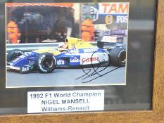 Formula 1; a framed and signed photograph, Nigel Mansell, frame 24 x 29cm