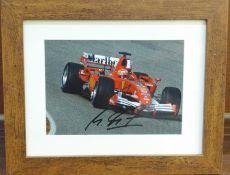 Formula 1; a framed and signed photograph, Michael Schumacher, frame 21.5 x 27cm