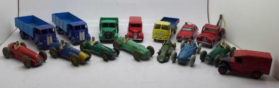 Eleven Dinky Toys model vehicles, three Corgi Toys model vehicles and one other model racing car