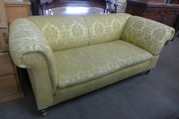 A Victorian mahogany and fabric upholstered upholstered Chesterfield drop arm settee, 75cms h, 184