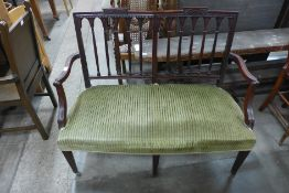 An Edward VII mahogany and upholstered salon settee