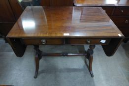A set of three oak dining chairs and a mahogany drop-leaf sofa table