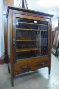 A Victorian inlaid rosewood music cabinet, 89cms h, 61cms w, 38cms d