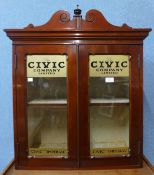 A Victorian mahogany counter top shop cabinet, bearing Civic Company Limited inscription to doors,