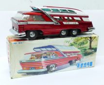 A Chinese battery operated tin-plate Mystery Action Bus, 28cm, boxed