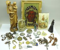 A collection of religious items including Rosary, medallions, figure, miniature travel figure,
