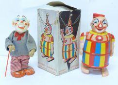 A plastic Battery Operated Walking Clown, made in Hong Kong, box lacking top, and a tin-plate and