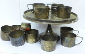 A Geo. Abrahamson Newman Galleries set of twelve silver plated cup holders and stand