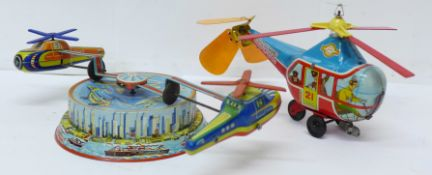 A tin-plate clockwork helicopter toy, made in Western Germany, and one other tin-plate clockwork toy