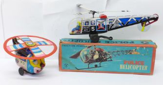 A Friction Powered tin-plate Police Helicopter, made in Japan, boxed, and a T.N. made in Japan tin-