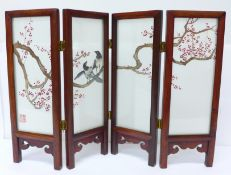 A circa mid 20th Century Chinese table screen with embroidered silk panels, decorated with two
