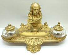 A c.1900 metal inkstand with two glass inkwells, one top a/f, mounted with a bust marked Cornelle