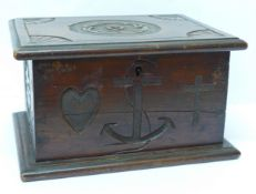 A wooden box with Faith, Hope and Charity carvings