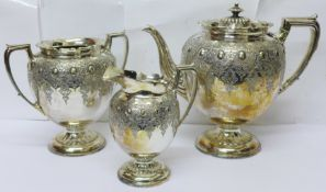 A three piece silver plated and embossed tea service
