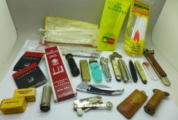 A cigar cutter marked Solingen, pipe knives and cleaners, lighters, Dunhill lighter flints, etc.