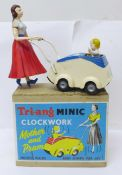 A Tri-ang Minic Clockwork Mother and Pram, boxed
