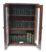 A set of miniature books, Works of Shakespeare, thirty-nine volumes and three others in a glazed