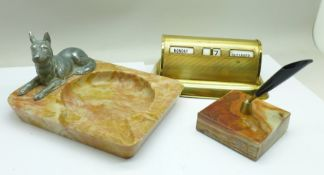 A Stratton perpetual desk calendar, a pen holder on an onyx base and a hardstone ashtray mounted