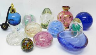 Eight glass paperweights and other glassware including a scent bottle, vase and a dish, etc.