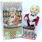 A Japanese Rosko tin-plate Battery Powered Bartender with revolving eyes, boxed