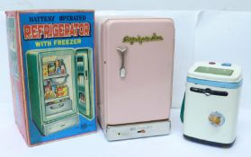 A tin-plated Battery Operated Refrigerator, made in Japan, boxed, and a tin-plate Automatic