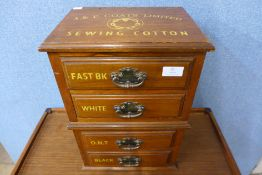 An early 20th Century walnut four drawer counter top haberdashery shop cabinet, bearing J&P Coates