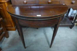 A George III inlaid mahogany demi-lune fold over card table, 74cms h x 92cms w