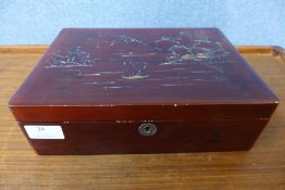 An early 20th Century Japanese export scarlet lacquered box, with mother of pearl inlay depicting