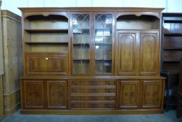A large yew wood bookcase, 210cms h, 290cms w, 48cms d