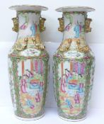 A pair of 19th Century Chinese export Canton Rose Medallion porcelain vases, with applied dragons