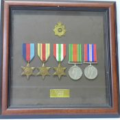 A framed WWII medal group to FJ Tarry T169519 R.A.S.C.