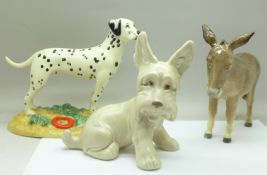 A Royal Doulton Dalmatian, a Beswick donkey and a Sylvac dog
