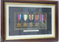 A framed WWII medal group to R A Wheeler, Royal Navy, the Africa Star with North Africa 1942-43 bar,