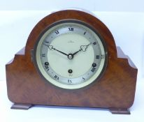 An Elliott mantel clock with chiming movement, the dial marked Cope, Nottingham