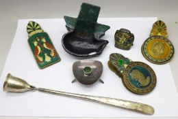 Three enamelled paper clips, cast iron doorstop, Danish candlestick, ball and candlesnuff
