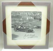 A framed signed photograph of Jack Brabham