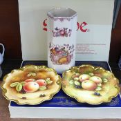 Two Coalport plates decorated with fruit, hand painted by Carole Gidman, a Mason's fruit basket vase