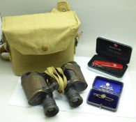 A pair of WWII military issue binoculars, Bino Prism No 2 x6, No 47302, a Wenger Swiss Army knife,