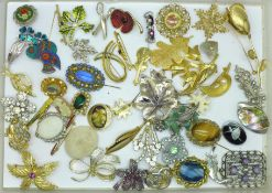 Forty-nine brooches and a pendant