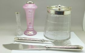 A glass biscuit barrel with plated top, two silver rimmed vases and a silver plated serving set