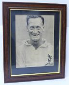 A framed signed picture of Preston North End and England footballer Tom Finney