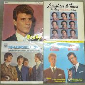Thirteen LP records; Status Quo, ABBA, The Bee Gees, Elton John